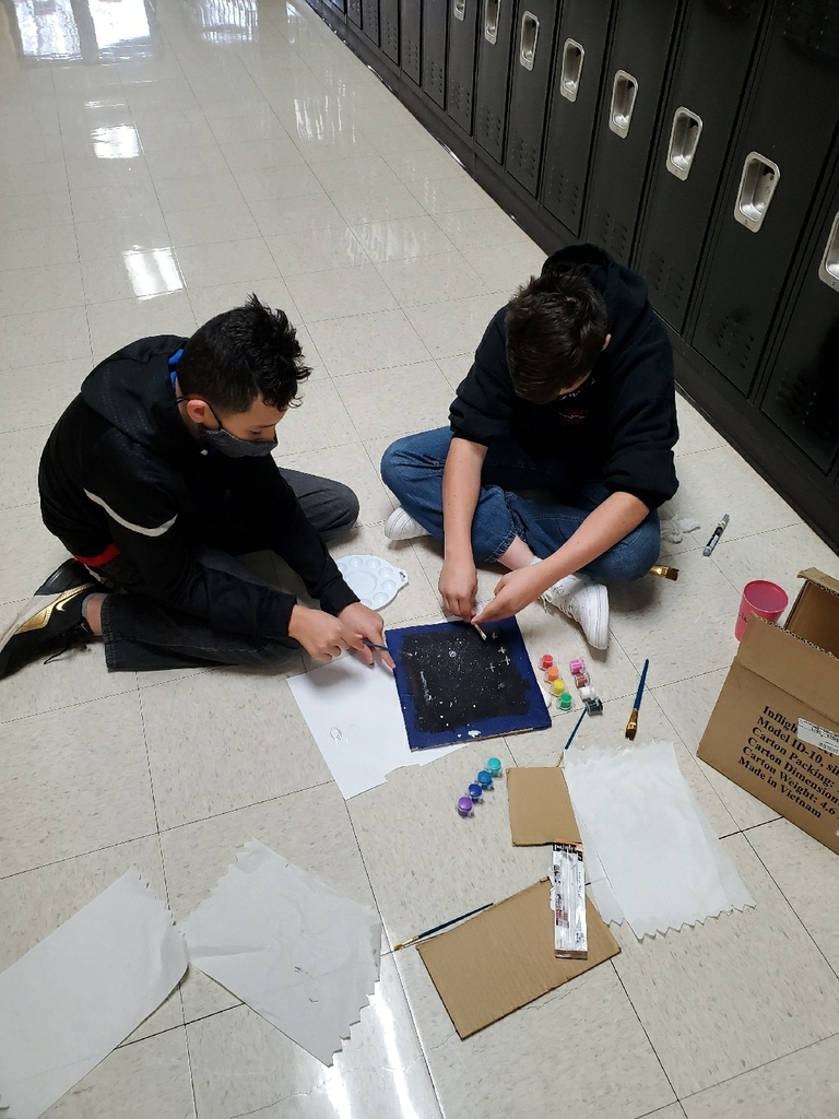 Students paint a game board.